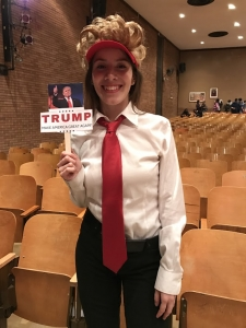 AnaMarie Martinez poses as Donald Trump in the Mock Debate